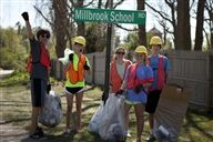 Students collect approximately a ton of trash during roadside cleanup on Earth Day.
